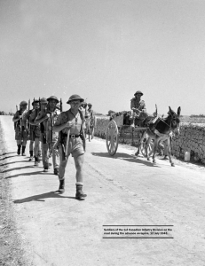 Soldiers of the 1st Canadian Infantry Division on the road during the